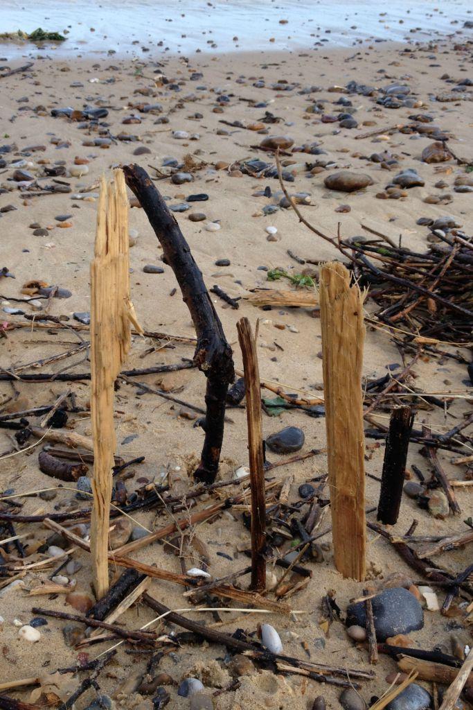 beach cricket activities with stones