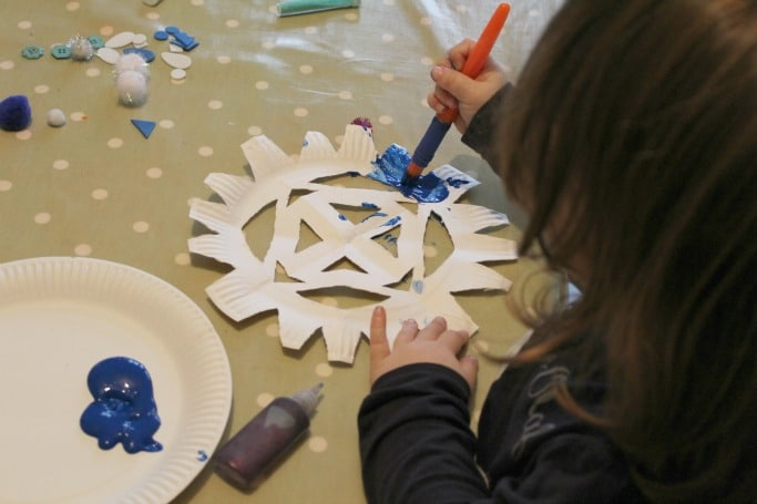 making paper plate snowflakes