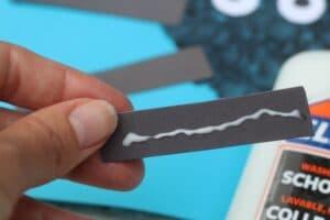 glueing legs spider craft for kids