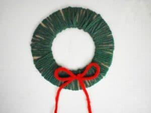 cardboard yarn wrapped wreath DIY