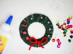 cardboard yarn wrapped wreath sequins glue
