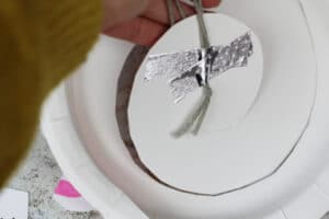 how to hang a paper plate twirler